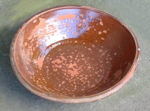 "A lead-glazed redware or ""dirt dish"""
