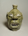 Face Jug: Local stoneware clay, kaolin details, alkaline glaze, wood-fired