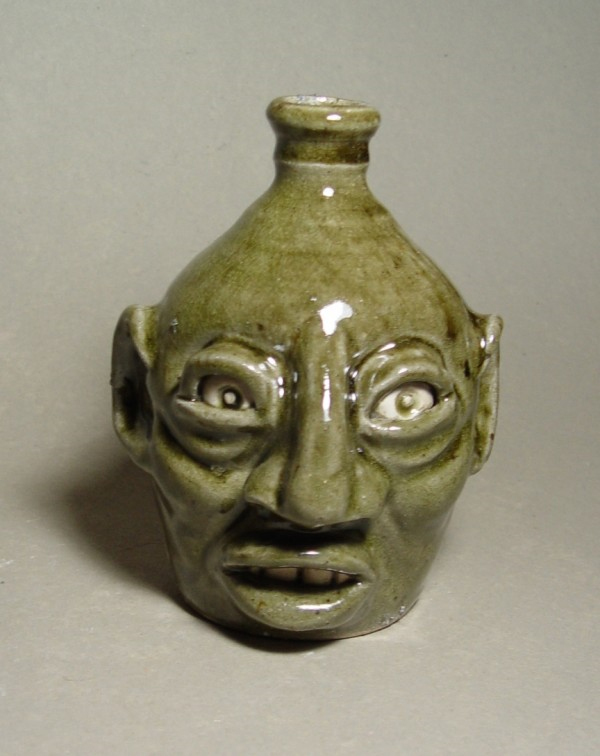 Face Jug: Local stoneware face jug with kaolin details, ash-glazed, wood
