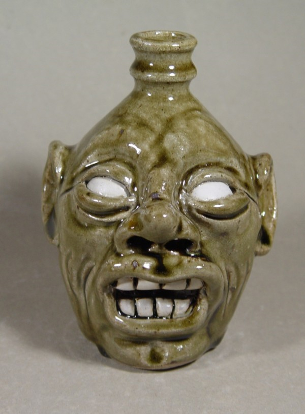 Face Jug: Local stoneware face jug with kaolin details, ash-glazed, wood-fired