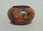 Horse Hair Raku Bowl: Porcelain with terra sigillata, colored with ferric chloride