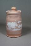 Lidded Pioneer Jar: Local clay with kaolin slip-trailed design, clear glaze